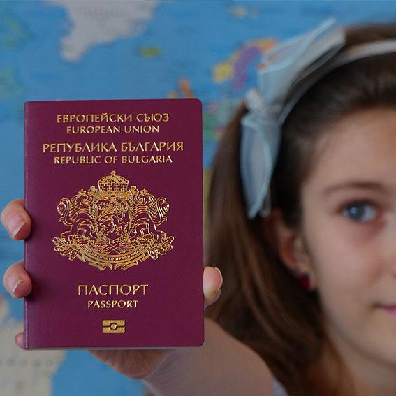 girl holding Bulgarian passport